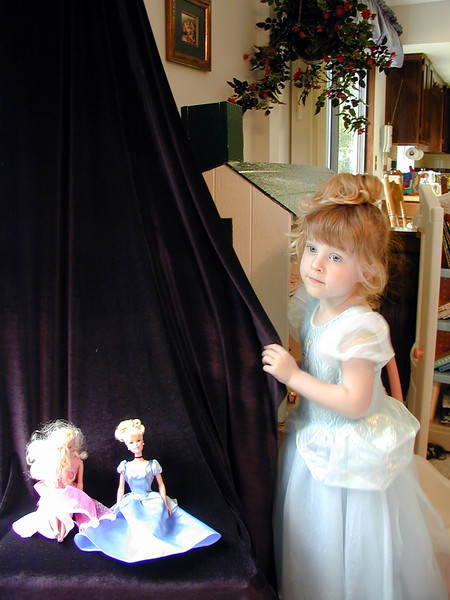 Charity preps the Princess Dolls for their photo shoot.JPG