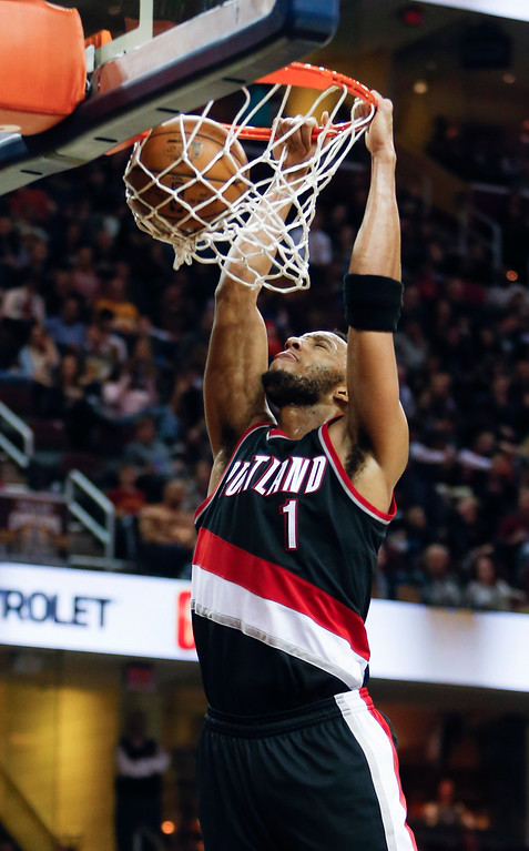 . Portland Trail Blazers\' Evan Turner (1) dunks against the Cleveland Cavaliers during the second half of an NBA basketball game Wednesday, Nov. 23, 2016, in Cleveland. The Cavaliers won 137-125. (AP Photo/Ron Schwane)