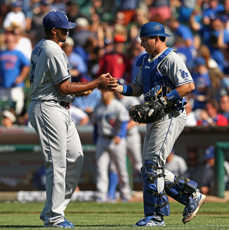 . CHICAGO, IL - AUGUST 04: Kenley Jansen #74 (L) and A.J. Ellis #17 of the Los Angeles Dodgers celebrate a win over the Chicago Cubs at Wrigley Field on August 4, 2013 in Chicago, Illinois. The Dodgers defeated the Cubs 1-0.  (Photo by Jonathan Daniel/Getty Images)
