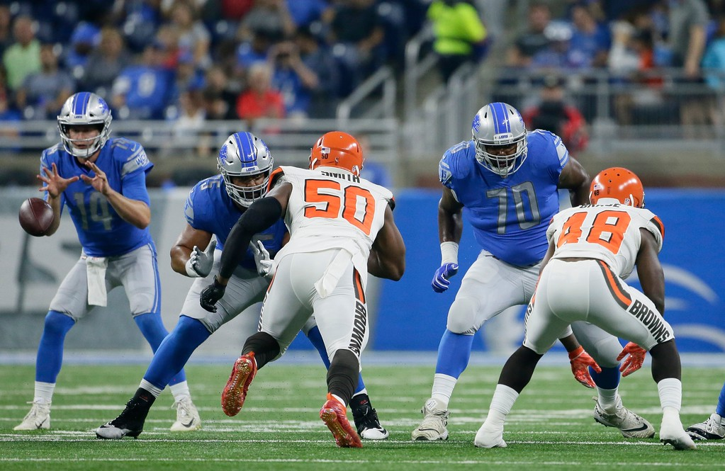 . Detroit Lions offensive tackle Corey Robinson (70) and center Leo Koloamatangi (75) defend as quarterback Jake Rudock (14) takes the snap during the first half of an NFL football preseason game against the Cleveland Browns, Thursday, Aug. 30, 2018, in Detroit. (AP Photo/Duane Burleson)