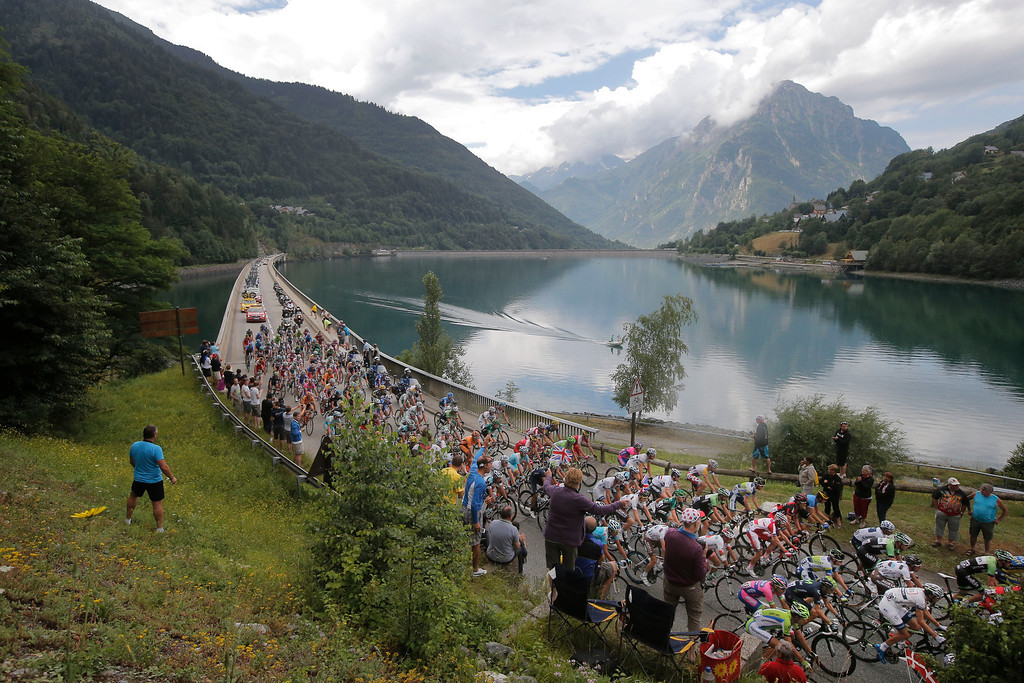 . The pack climbs towards Glandon pass during the nineteenth stage of the Tour de France cycling race over 204.5 kilometers (127.8 miles) with start in in Bourg-d\'Oisans and finish in Le Grand-Bornand, France, Friday July 19 2013. (AP Photo/Laurent Cipriani)