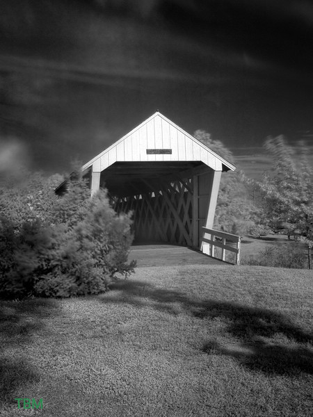 The oldest of the remaining covered bridges, Imes was built in 1870 and is 81 feet in length. It was originally located over the Middle River west of Patterson. In 1887 it was moved to a spot over Clinton Creek southwest of Hanley. Imes Bridge was moved again to its present site over a natural ravine just east of St. Charles in 1977. It was renovated in 1997 at a cost of $31,807. LATITUDE: 41.28906941138379 LONGITUDE: -93.800910115242