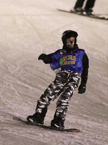 Noah Bruns, 12, of Carlisle, snowboarding at Nashoba Valley Ski Area with the Carlisle Rec Ski Club. (SUN/Julia Malakie)