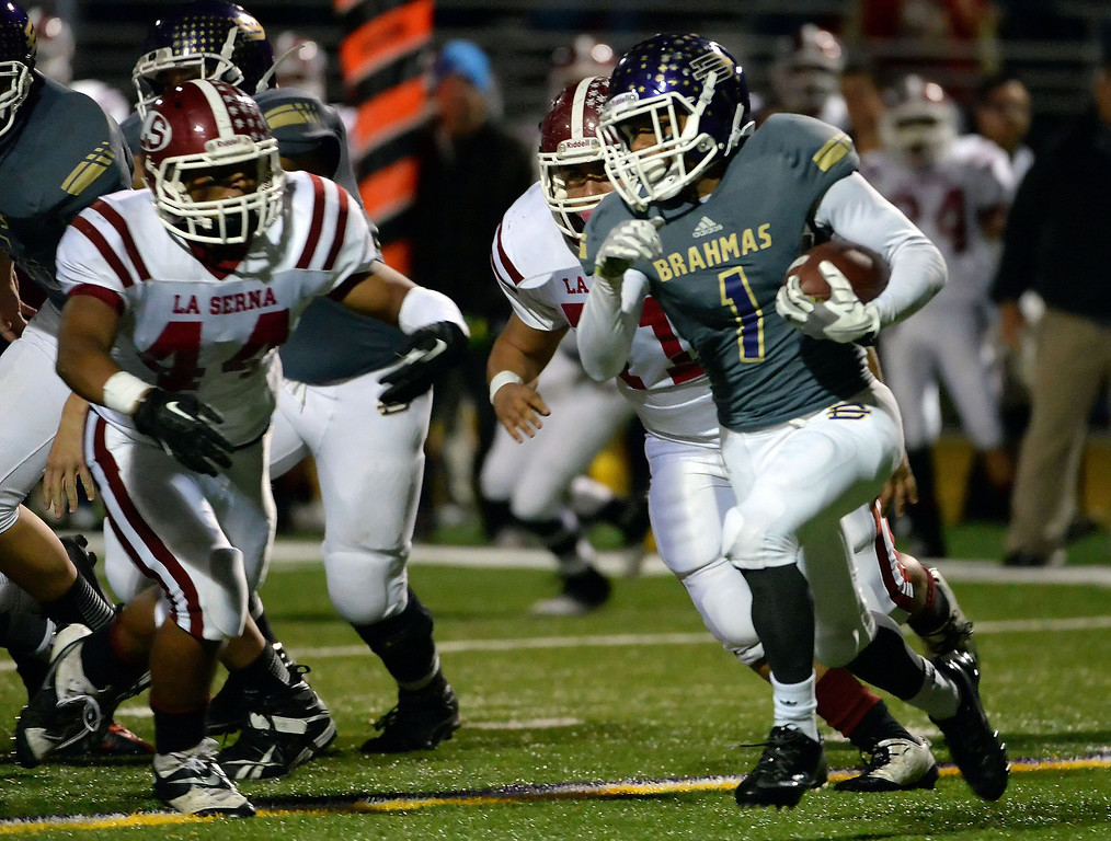 . Diamond Bar\'s Tyler Brown (C) (1) runs for yardage against La Serna in the first half of a CIF-SS playoff football game at Diamond Bar High School in Diamond Bar, Calif., on Friday, Nov. 22, 2013.   (Keith Birmingham Pasadena Star-News)
