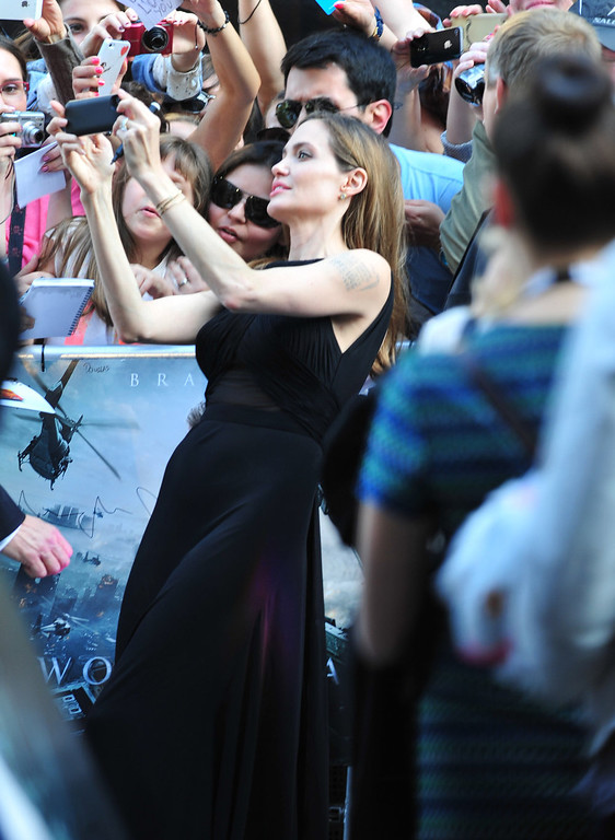 . Angelina Jolie greets fans at the World Premiere of \'World War Z\' at the Empire Cinema in London on Sunday June 2nd, 2013. (Photo by Jon Furniss/Invision/AP Images)