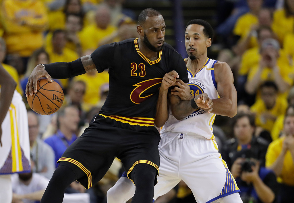 . Cleveland Cavaliers forward LeBron James (23) drives on Golden State Warriors guard Shaun Livingston during the first half of Game 2 of basketball\'s NBA Finals in Oakland, Calif., Sunday, June 4, 2017. (AP Photo/Marcio Jose Sanchez)