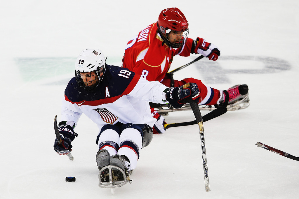 . Taylor Chace of the USA makes a break during the ice sledge hockey gold medal game between the Russian Federation and the United States of America at the Shayba Arena during day eight of the 2014 Paralympic Winter Games on March 15, 2014 in Sochi, Russia.  (Photo by Hannah Peters/Getty Images)