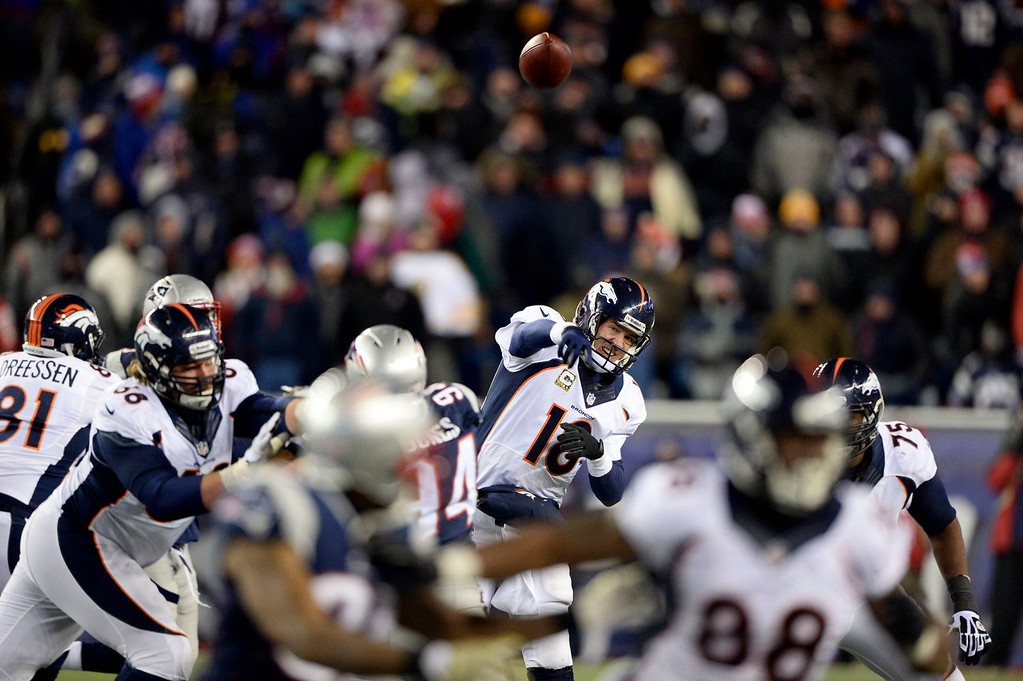 . Denver Broncos quarterback Peyton Manning (18) throws a pass down field during the fourth  quarter against the  New England Patriots November 24, 2013 at Gillette Stadium. (Photo by John Leyba/The Denver Post)