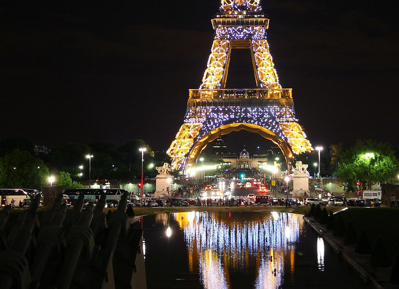 Every night on the hour the Eiffel Tower breaks out into a special light show with high intensity, quick-flashing, bluish-white strobe lights all over. It lasts about 5 minutes. The amber lights stay on all the time.