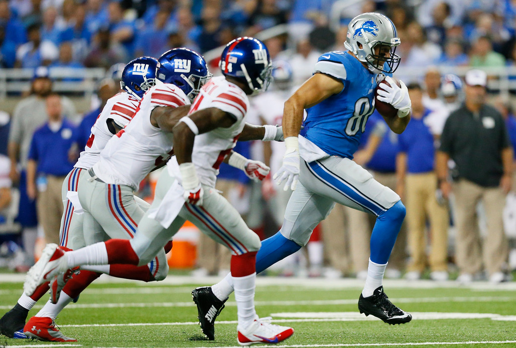 . Detroit Lions tight end Joseph Fauria (80) breaks for a 26-yard run during the third quarter of an NFL football game against the New York Giants in Detroit, Monday, Sept. 8, 2014. (AP Photo/Rick Osentoski)