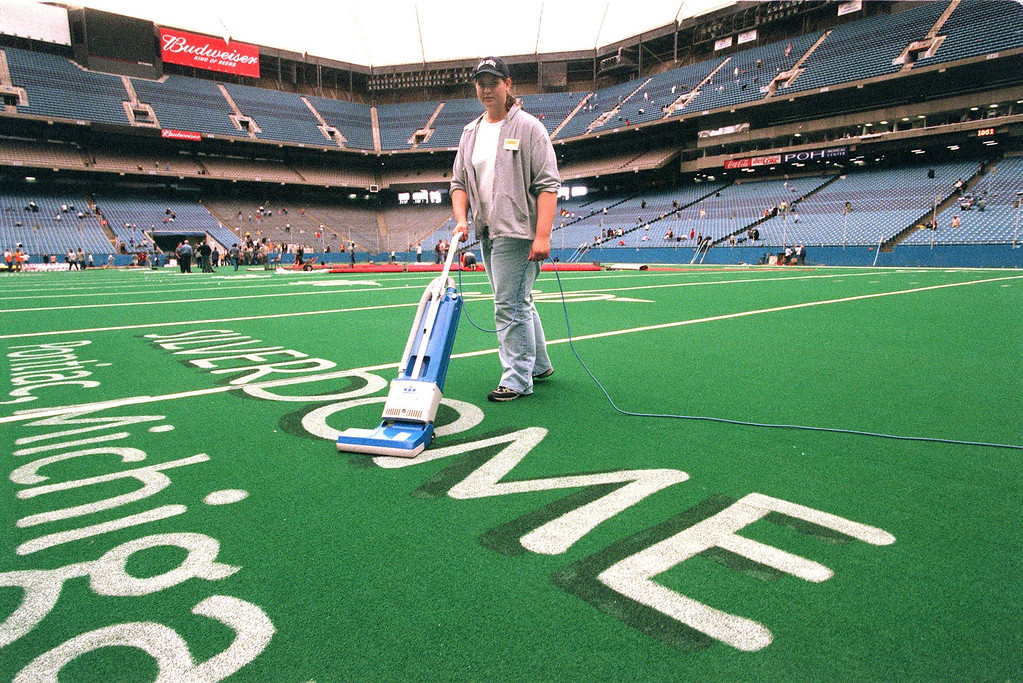 . Stacey Ivey from Brighton, Mi. vacuums the Silverdome carpet getting ready for the Jehovah\'s Witness  annual conference set for this weekend.