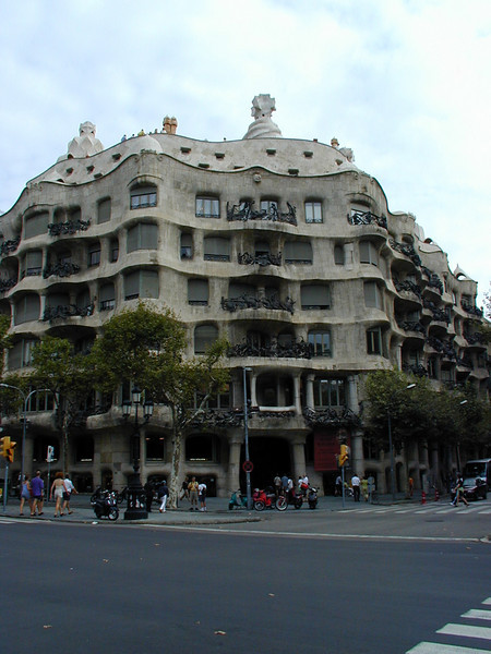 "Left, Rick Steves describes Casa Mila (La Pedrera) as, a ""roller coaster of melting ice cream eves."" Designed by Gaudi, the top floor is a museum and the roof a sculpture garden. The apartments are home to some of the wealthiest of Barcelona. Recommended."