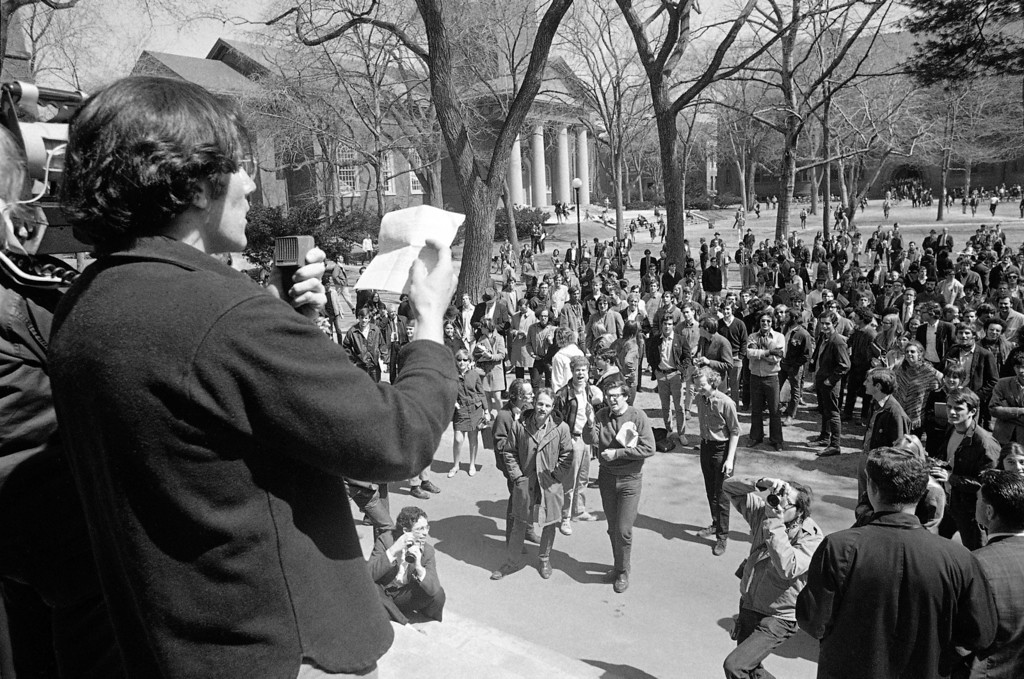 """. In this April 9, 1969 file picture, a student leader speaks from steps of the Harvard administration building at Cambridge, Mass. as part of a protest against Reserve Officers Training Corps program at the university. Forty years ago, ROTC units disappeared from Yale, Harvard, Columbia, Stanford and other elite schools, casualties of Vietnam-era tension and academic power struggles. Now, those same schools are moving toward welcoming ROTC units back thanks to the imminent demise of \""""don\'t ask, don\'t tell,\"""" the policy barring gays from serving openly in the U.S. military. (AP Photo/Bill Chaplis)"""
