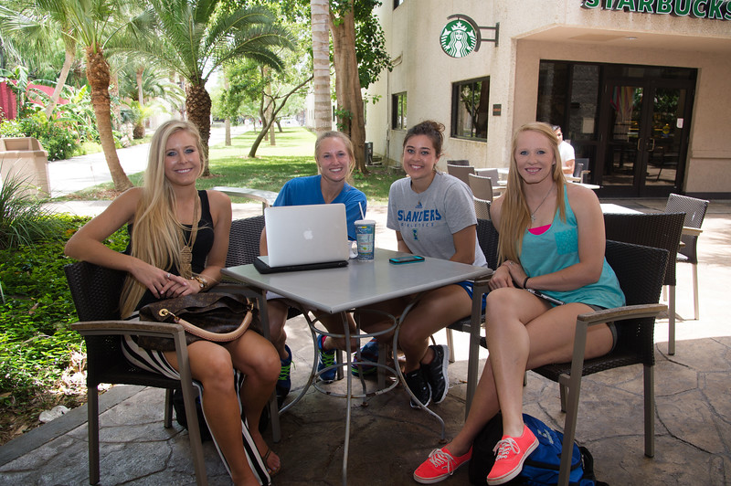 Students Brianna Brink, Shayla Maldonado, Chelby Stanford and Hailey Kince study for their education class right outside the Mary and Jeff Bell library.