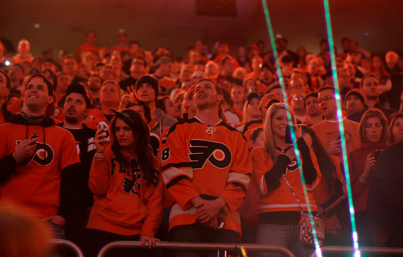. Fans wait before an NHL hockey game between the Pittsburgh Penguins and Philadelphia Flyers Saturday, Jan.19, 2013, in Philadelphia. (AP Photo/Mel Evans)