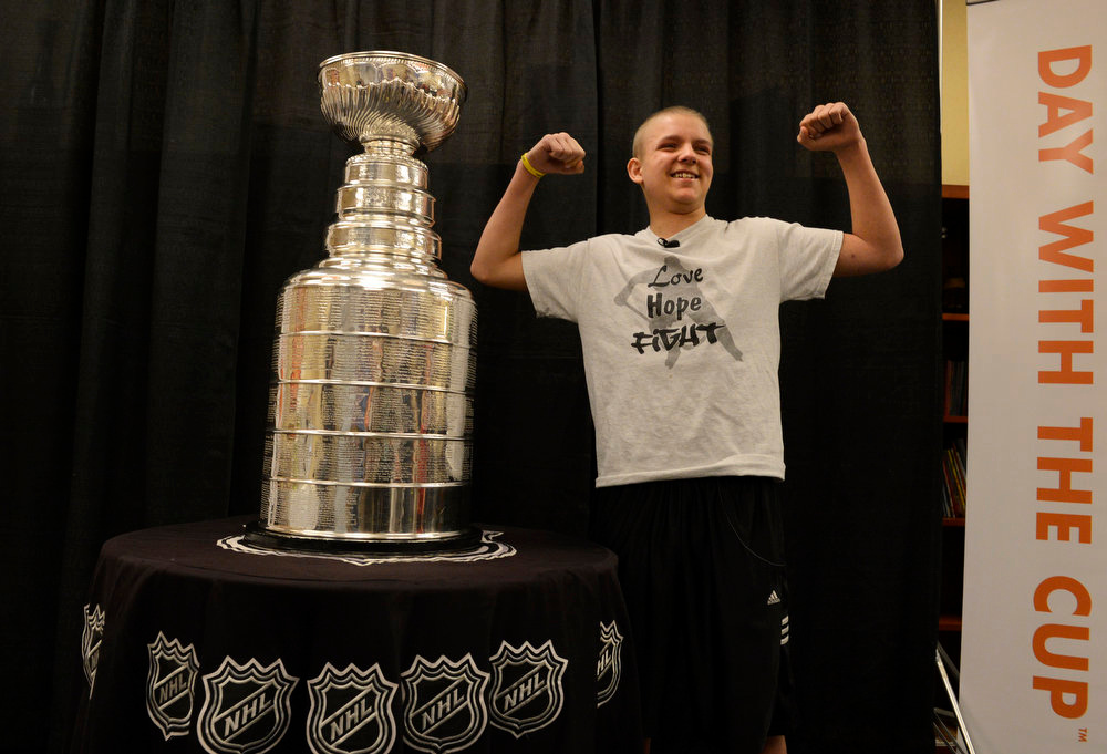 . Logan Piz, 13, poses for a picture with the Stanley Cup at Rocky Mountain Hospital for Children in Denver, CO on May 15, 2013. The hospital, Make-A-Wish, Discover and the National Hockey League teamed up to grant Logan\'s wish to spend a day with the Stanley Cup and share it with friends, family and supporters. Logan has not played hockey since he was diagnosed with Ewing�s sarcoma in November 2012. Joining Logan were his mother and father, Tammy and Ron and his brother, Hayden, 9. (Photo By Craig F. Walker/The Denver Post)