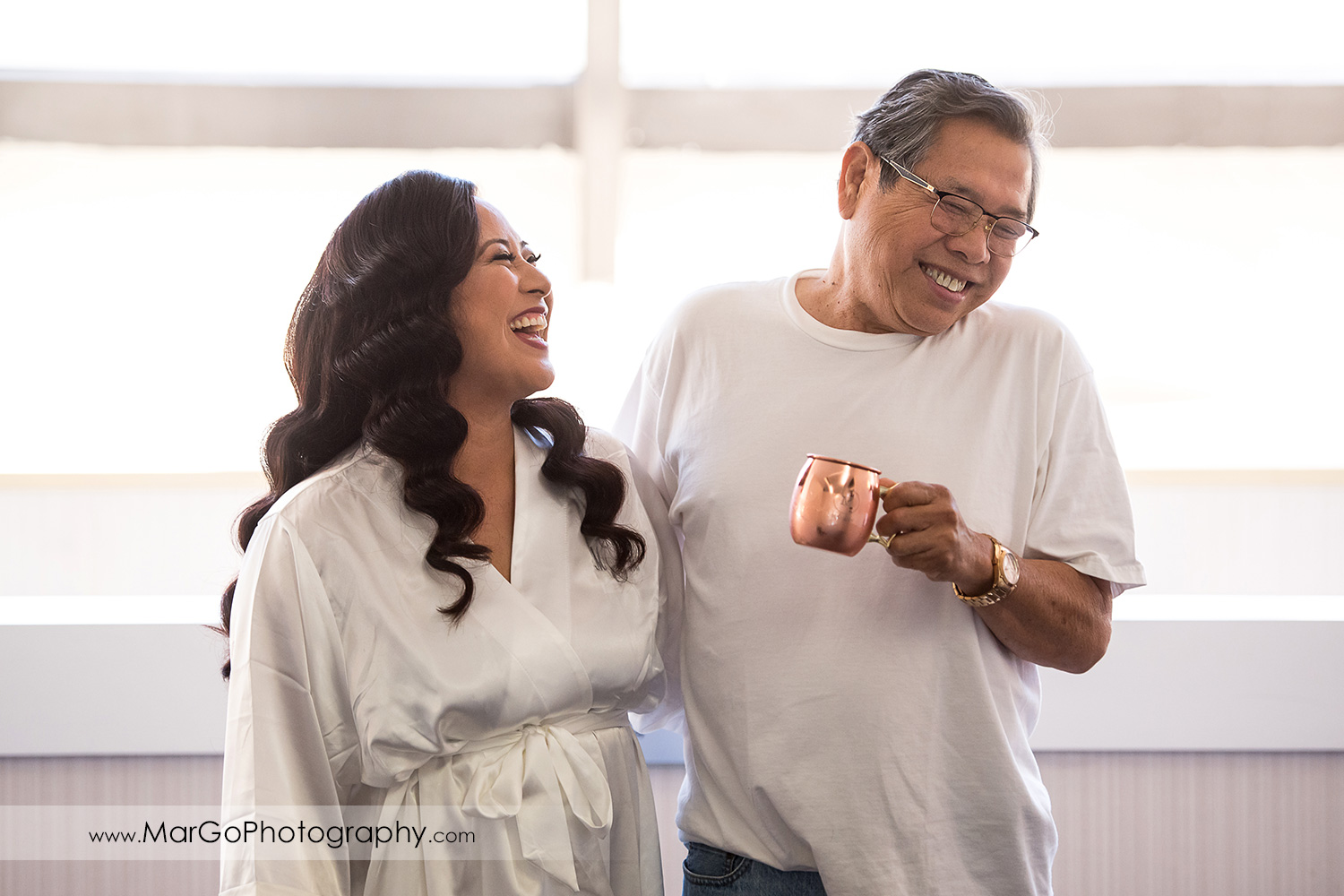 bride laughing with her dad at Pleasanton Marriott