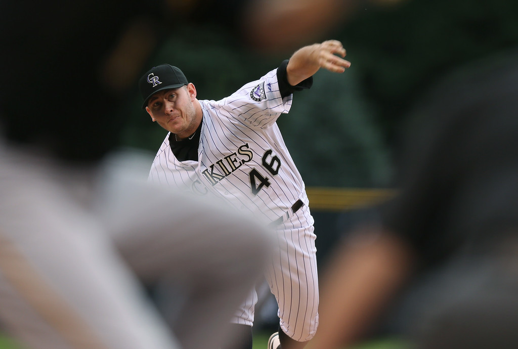. Colorado Rockies starting pitcher Tyler Matzek works against the Pittsburgh Pirates in the first inning of a baseball game in Denver on Saturday, July 26, 2014. (AP Photo/David Zalubowski)