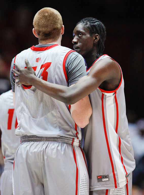 . New Mexico\'s Tony Snell, right, hugs teammate Alex Kirk near the end of an NCAA college basketball against Wyoming in Albuquerque, N.M., Saturday, March 2, 2013. New Mexico won 53-42. (AP Photo/ Craig Fritz)