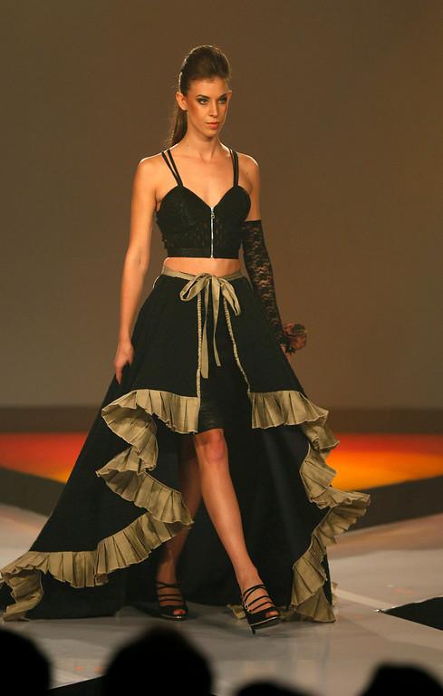 . In this Wednesday, April 3, 2013 photo, a Sri Lankan model presents a creation by Charini Suriyage during Colombo Fashion Week in Colombo, Sri Lanka. (AP Photo/Eranga Jayawardena)