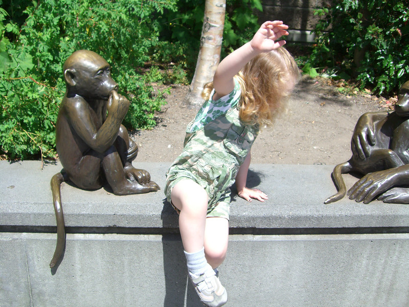 (Trying to) pose with the monkey statues by the zoo entrance.