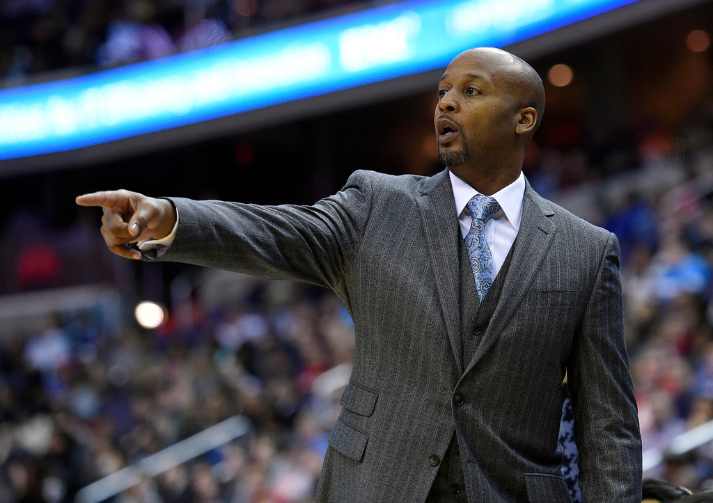 . Denver Nuggets head coach Brian Shaw points during the first half of an NBA basketball game against the Washington Wizards, Friday, Dec. 5, 2014, in Washington. (AP Photo/Nick Wass)