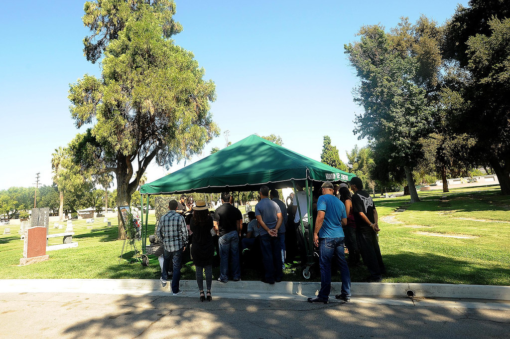 """. About 40 people family and friends gather for a tribute for Charles \""""Mask\""""  Lewis Jr. at Mountain View Cemetery in San Bernardino, CA on Saturday September 7, 2013.  (Photo by Gabriel Luis Acosta/San Bernardino Sun)"""