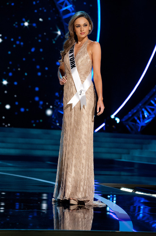 . This photo provided by the Miss Universe Organization, Miss New York USA 2013, Joanne Nosuchinsky competes in her evening gown during the 2013 Miss USA Competition Preliminary Show  in Las Vegas  on Wednesday June 12, 2013.  She will compete for the title of Miss USA 2013 and the coveted Miss USA Diamond Nexus Crown on June 16, 2013.  (AP Photo/Miss Universe Organization, Patrick Prather)