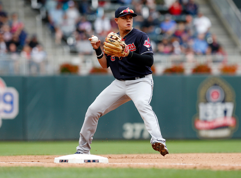 . Cleveland Indians third baseman Giovanny Ursula fields a grounder against the Minnesota Twins in the first game of a baseball doubleheader Thursday, Aug. 17, 2017, in Minneapolis. (AP Photo/Jim Mone)