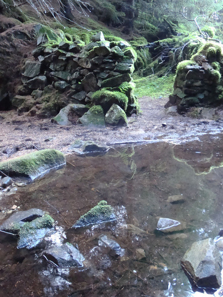 Adjoining a secret pool, this ruin was hidden in the dark heart of the forest. I wonder what mysterious history these stones held. It seemed the perfect place for witches or outlaws...