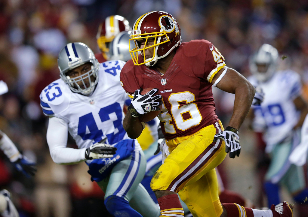 . Washington Redskins running back Alfred Morris (46) outruns Dallas Cowboys free safety Gerald Sensabaugh (43) for a touchdown during the first half of an NFL football game Sunday, Dec. 30, 2012, in Landover, Md. (AP Photo/Evan Vucci)