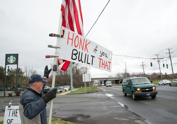 04/15/19 Wesley Bunnell | Staff Local TEA Party members protested taxes on Queen St. in Southington on April 15th which is the federal deadline for filing taxes. Tucker Deming holds an American flag and sign during the protest.