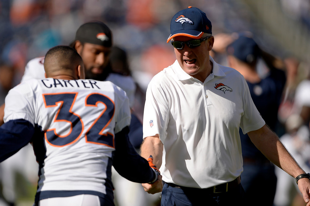 . SAN DIEGO, CA. December 14, - Head coach John Fox of the Denver Broncos with cornerback Tony Carter #32 of the Denver Broncos before the game vs the San Diego Chargers at Qualcomm Stadium December 14, 2014 San Diego, CA (Photo By Joe Amon/The Denver Post)