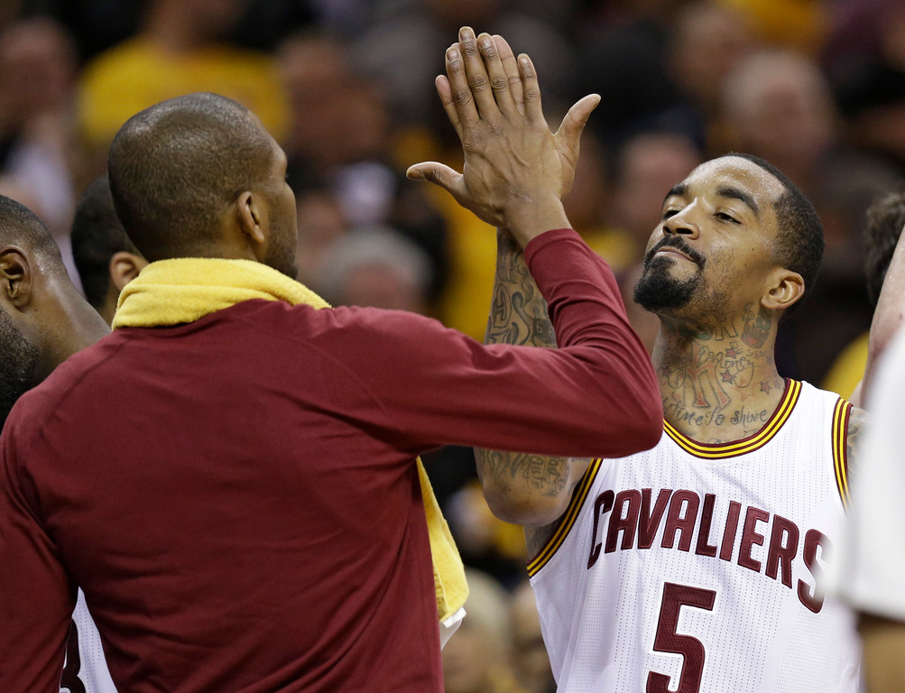 . Cleveland Cavaliers\' J.R. Smith, right, celebrates with James Jones in the second  half in Game 1 of a second-round NBA basketball playoff series, Monday, May 2, 2016, in Cleveland. (AP Photo/Tony Dejak)