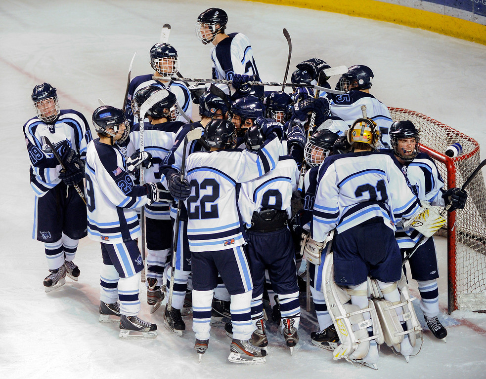 . DENVER, CO. - FEBRUARY 28: The Mustangs surrounded winning goalie Tyler Anderson Thursday night. Ralston Valley High School defeated Resurrection Christian 5-1 Thursday night, February 28, 2013 in a semifinal match in the Colorado State Ice Hockey Championships at Magness Arena in Denver. The Mustangs advanced to play in the title game Friday night. (Photo By Karl Gehring/The Denver Post)