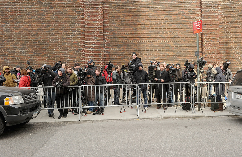 . The press waits  at The scene outside the Chelsea apartment building on March 17, 2014 in New York City, where fashion designer L\'Wren Scott, 47, was found dead from an apparent suicide.  (Photo by Jamie McCarthy/Getty Images)