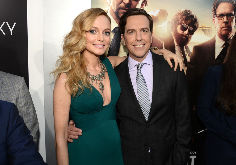 """. Actors Heather Graham (L) and Ed Helms arrives at the premiere of Warner Bros. Pictures\' \""""Hangover Part 3\"""" on May 20, 2013 in Westwood, California.  (Photo by Kevin Winter/Getty Images)"""