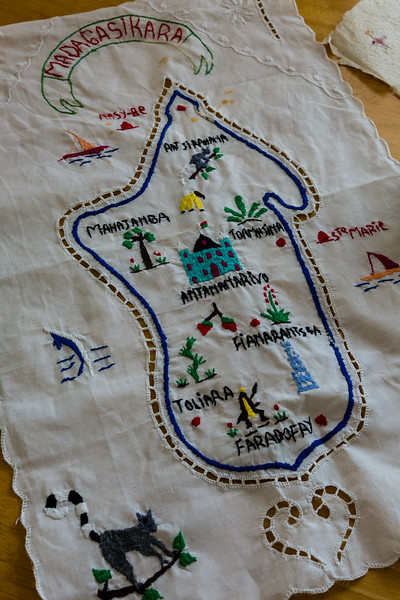 An embroidered map of Madagascar that Jenny Mullins purchased at the Bazaar Be market in Madagascar while serving aboard the Mercy Ship 'The African Mercy'. Mullins served for 10 months on the hospital ship, which treated just under 1,500 patients for varying ailments. Photo taken on Wednesday, July 13, 2016, in Jenny's home in Royal Palm Beach, Florida. (Joseph Forzano / The Palm Beach Post)