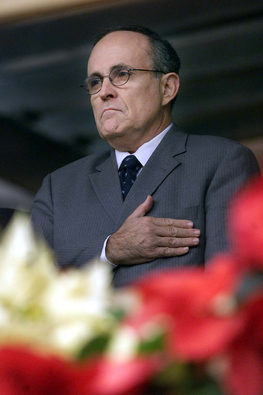 . 2001: Rudolph Giuliani. New York City Mayor Rudolph Giuliani stands with his hand over his heart as a trumpeter plays the national anthem at the ground zero site of the World Trade Center disaster in New York shortly after 8:46 a.m. EST, Tuesday, December 11, 2001, during a ceremony marking the three month anniversary of the attack on the center. More than three thousand people died in the attack on the twin towers September 11.(AP Photo/Mike Segar. pool)