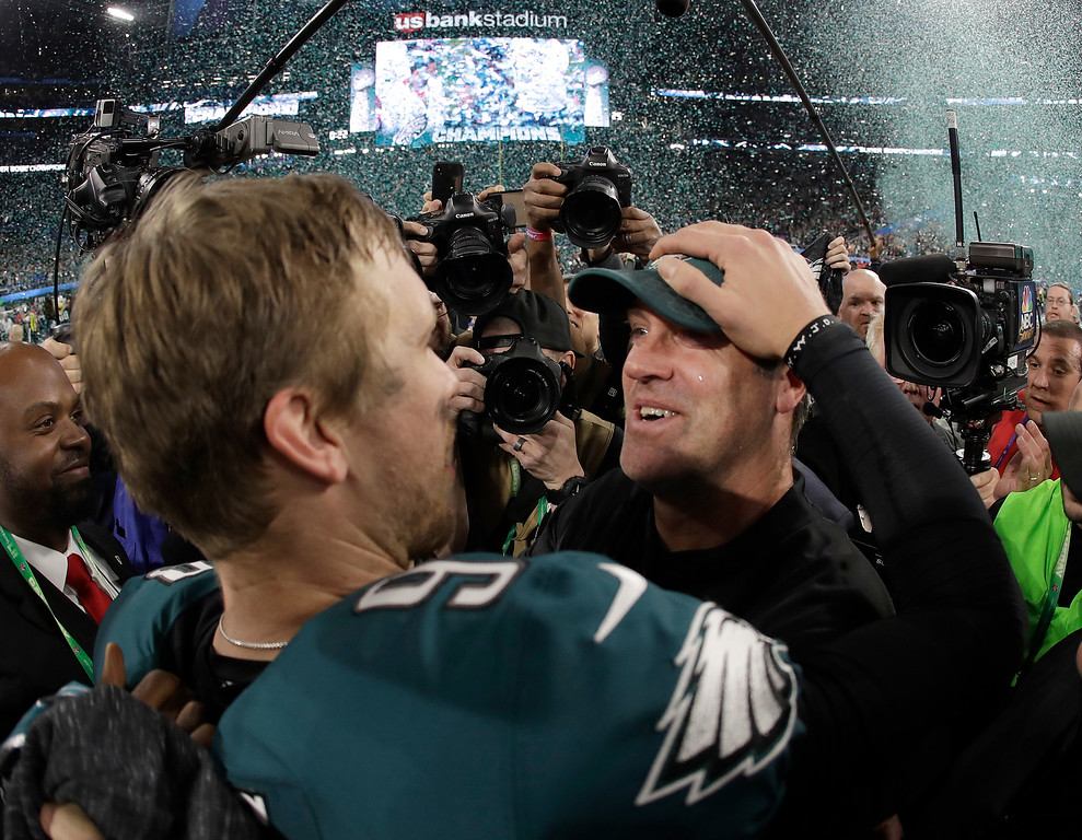 . Philadelphia Eagles\' Nick Foles, left, celebrates with head coach Doug Pederson after the NFL Super Bowl 52 football game against the New England Patriots, Sunday, Feb. 4, 2018, in Minneapolis. The Eagles won 41-33. (AP Photo/Matt Slocum)