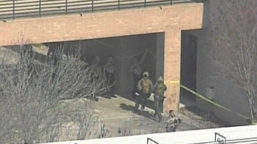 . Tactical response officers run into a building on the Lone Star College Campus near Houston, Texas in this still image taken from video courtesy of KPRC-TV Houston January 22, 2013.  Multiple people have been shot according to news reports.  REUTERS/KPRC-TV Houston/Handout