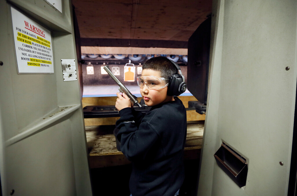 . Andrew Josequera, 11, prepares to shoot at a target at the Los Angeles gun club in Los Angeles, January 23, 2013.   REUTERS/Lucy Nicholson