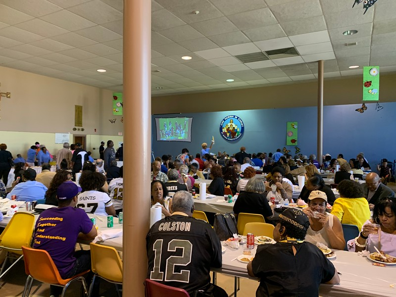 Parishioners enjoy their meal as the New Orleans Saints play the Jacksonville Jaguars. The Saints won the game 13 - 6