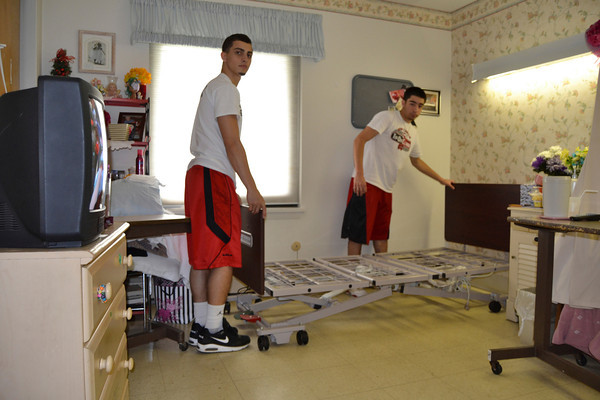 Athletes assemble nursing home beds — 05-13-14