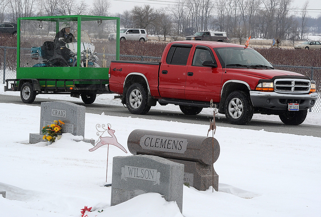 . The family of Billy Standley, of Mechanicsburg, Ohio, carried out his wish to be buried on his 1967 Harley Davidson motorcycle Friday, Jan. 31, 2014, hauling a large Plexiglas casket to Fairview Cemetery in Crawford County, Ohio. Standley\'s family said he\'d been talking about being buried on his Harley for years. His sons, Pete and Roy, fashioned the casket out of Plexiglas, reinforcing the bottom with wood and steel rods to handle the extra weight. Five embalmers worked to prepare Standley\'s body with a metal back brace and straps to ensure he\'ll never lose his seat. (AP Photo/The News-Sun, Marshall Gorby)