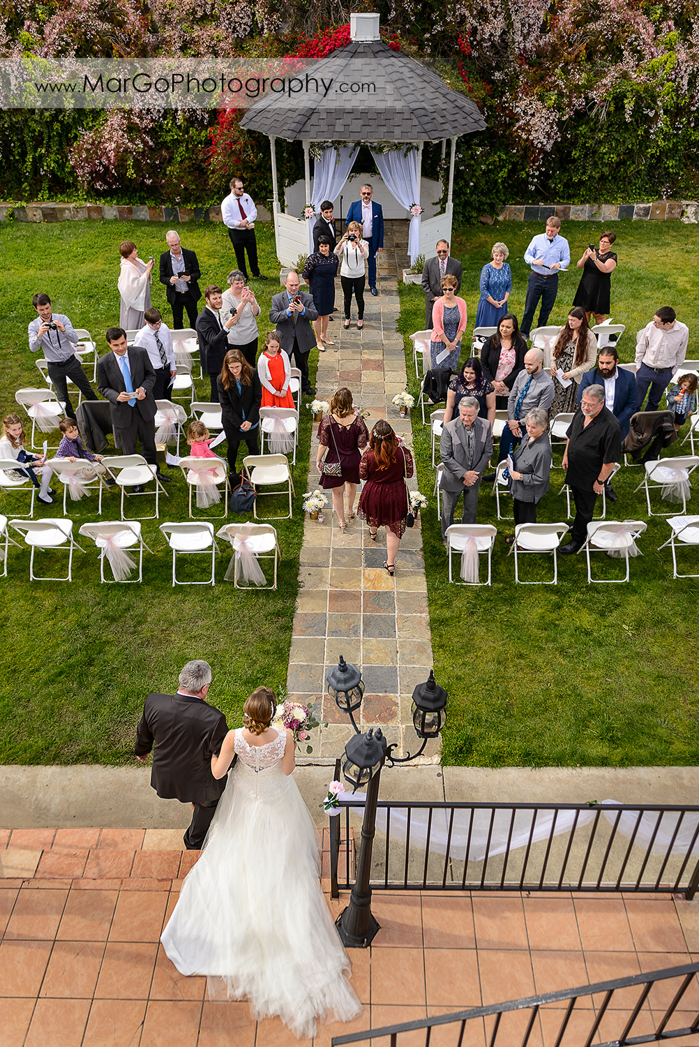 bride walking down the aisle with her dad during wedding ceremony at Fremont Century House & Gardens