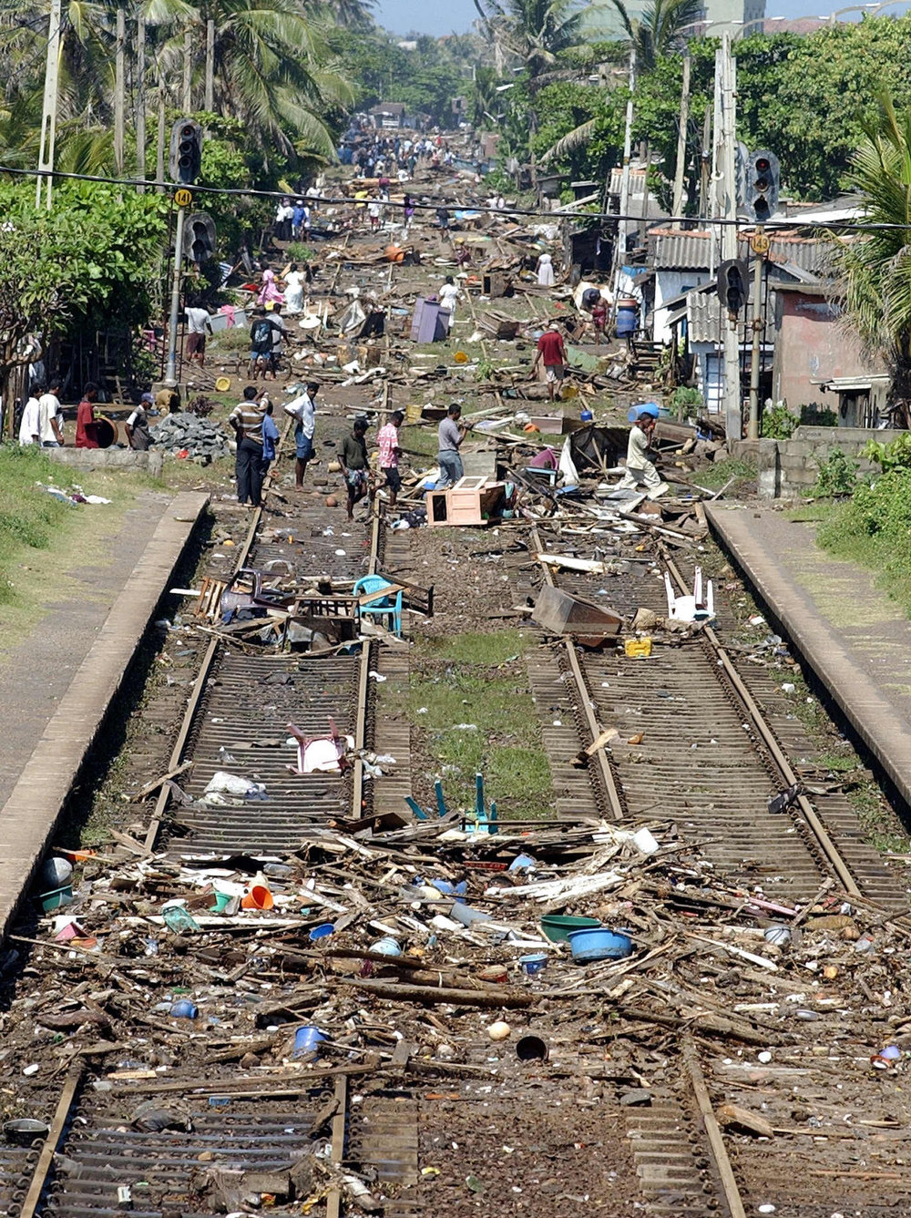 . The trail of destruction along the coastal railway line in the southern Sri Lankan town of Lunawa is seen in this picture taken 26 December 2004 after tsunami tidal waves lashed more than half of Sri Lanka\'s coastline. The tsunami tidal waves weakened as it hit the capital Colombo, but elsewhere at least 1000 people were killed and hundreds were missing.    SENA VIDANAGAMA/AFP/Getty Images