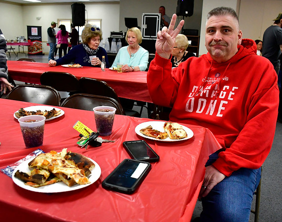 3/14/2019 Mike Orazzi | Staff David LaFleur while enjoying some pizza during the Plainville Chamber of Commerce 2019 Pizza Feud at the Veterans of Foreign Wars in Plainville Thursday evening.