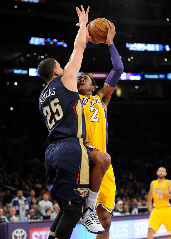 . Los Angeles Lakers guard MarShon Brooks (2) battles New Orleans Pelicans guard Austin Rivers (25) as he goes to the basket in the second half of an NBA basketball game, Tuesday, March 4, 2014, in Los Angeles. The Pelicans won 132 to 125. (AP Photo/Gus Ruelas)