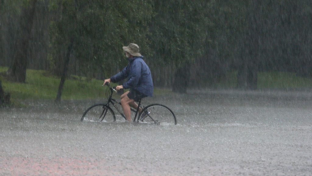 . A bicyclist rides through rising floodwaters from Tropical Storm Harvey in Houston, Texas, Sunday, Aug. 27, 2017. (AP Photo/LM Otero)